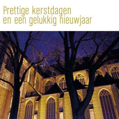 Kerstkaart van AlKmaarse Laurenskerk uitgelicht.