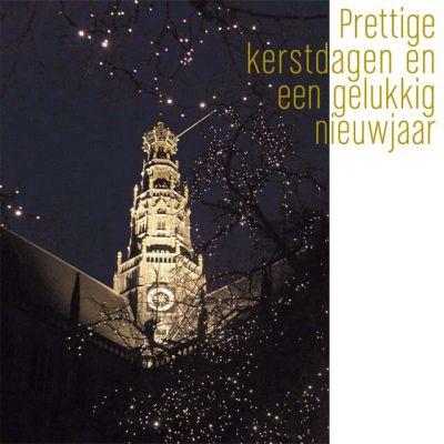 Haarlemse kerstkaart van sfeervol verlichte Grote of St. Bavokerk