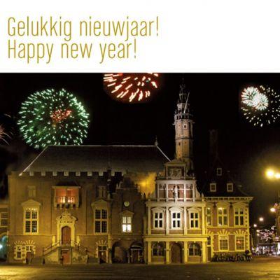 Nieuwjaarskaart Haarlem met stadhuis en vuurwerk