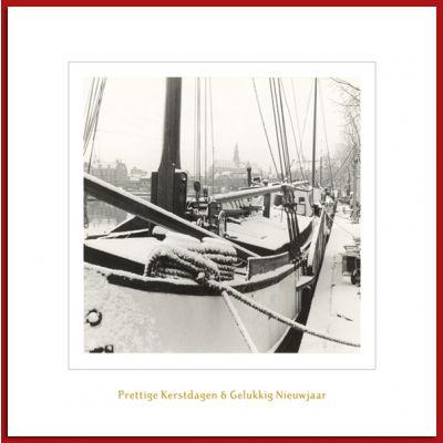 Haarlemse kerstkaart met historische foto van schepen aan het Spaarne.